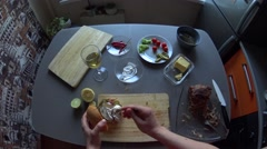 Girl making pulled pork burger on her kitchen: spooning mayo on meat - stock footage