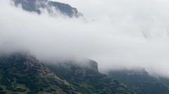 Clouds Rolling over a Mountain Time lapse Stock Footage
