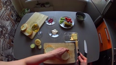 Female hands spreading butter on toasted burger buns on her kitchen, pov - stock footage