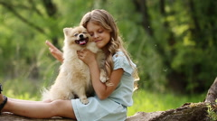 Little girl stroking dog Stock Footage