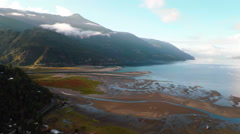 Aerial: Flyover blue lake and green river delta and mountains in Patagonia Stock Footage