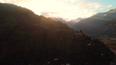 Aerial: Sunrise over mountains with river and road in Patagonia with lens flares Stock Footage
