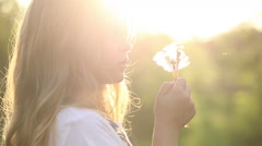 Little girl blow a dandelion - stock footage