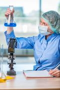 Experienced lab assistant working on chemical solutions Stock Photos