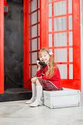 Little girl with handset Stock Photos