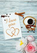 Cup of coffee and inscription in notepad: I love you Stock Photos
