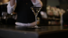 4K Smiling bartender prepares & serves a fresh cocktail for customer.  Stock Footage