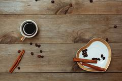 cup black coffee on saucer in form of heart - stock photo