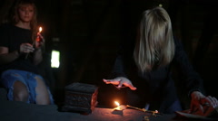 witch holding the magic ritual. old book and candle. halloween - stock footage