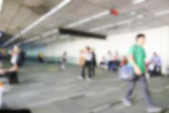 Blurry defocused image of passenger at the airport terminal Kuvituskuvat