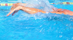 Professional swimmer is swimming butterfly in a pool. Butterfly training. Stock Footage