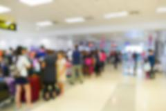 blurry defocused image of passenger at the airport terminal - stock photo