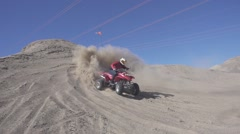 Slow motion shot of quad with big sand ejection front view Stock Footage