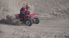 Slow motion shot of quad with big sand ejection top view Stock Footage