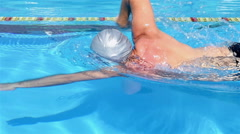 Professional swimmer is swimming freestyle in a pool. Freestyle training. Stock Footage