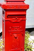 Classic red postal mailbox Stock Photos