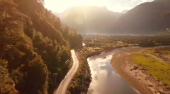 Aerial: Mountain road next to river in valley Patagonia during sunrise 2k Stock Footage