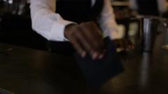4K Smiling bartender prepares & serves a fresh cocktail for customer Stock Footage