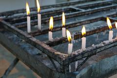 Candle light in buddisht temple Stock Photos