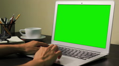 Women's hands typing on laptop green screen Stock Footage