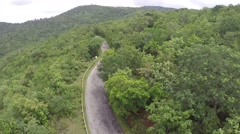 Fly over a Hill with a Road Stock Footage