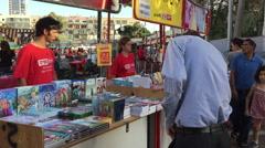 TEL AVIV  JUNE 21 2016 People buy Books at  Week Fair.mov - stock footage