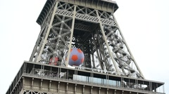 Huge soccer ball suspended on the Eiffel Tower during EURO 2016 Stock Footage