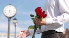 Couple meeting on a date, young man giving red rose to his beautiful girlfriend Stock Footage