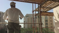 Construction worker on a scaffold Stock Footage