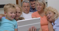 Big family with child watching tablet computer Stock Footage