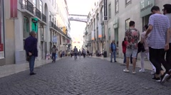 LISBON JUNE 5 2016 Commutors pass in the street Stock Footage