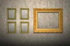 Antique old picture frame on marble wall - stock photo