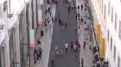 LISBON JUNE 5 2016 Commutors pass the street in timelapse Stock Footage