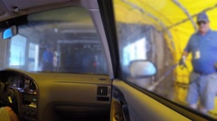 Interior of a car being cleaned in car wash Stock Footage