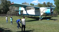 Children playing near a rare old plane  Stock Footage