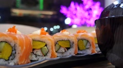 Eating Sushi rolls in a restaurant Stock Footage