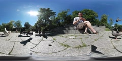 360Vr Video Man is Feeding a Pigeons in Park Lake Embankment Birds Are Walking Stock Footage