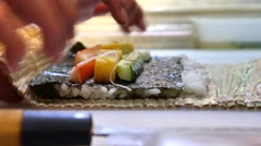 Sushi Chef Preparing Salmon Peach Futomaki Roll. A sushi-man cooking Stock Footage