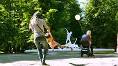 Slow motion.  Happy mother with  girl in summer city park - stock footage