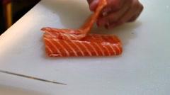 Sushi Chef Slicing a Salmon Steak Nigiri Style A sushi-man slicing a salmon Stock Footage