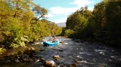 Aerial: Flyover Whitewater Rafters Going  Down Stream In Patagonia River Chile Stock Footage
