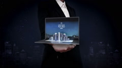 Businessman open palms, keyboard on notebook pc, tablet changed modern building. Stock Footage