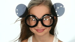 Teen girl posing in funny glasses, slow motion - stock footage