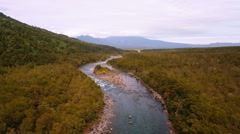 Aerial: Crystal Clear Mountain River Going Through Forrest In Patagonia Chile 2K Stock Footage