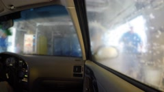 Interior of car being cleaned in a car wash - stock footage
