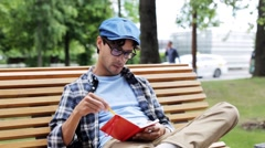 Man drawing to sketchbook with pencil on street Stock Footage