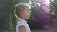 Cute little kid girl portrait walk on nature park point finger to her parent Stock Footage