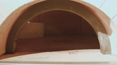 Moving inside empty commercial wood fired stone pizza oven. Stock Footage