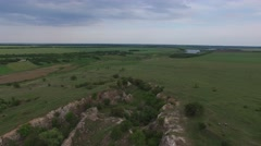 Flying over small canyon, pastures, cultivated fields. Ukraine Stock Footage