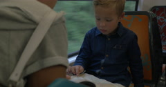 Mother and child exploring map in train Stock Footage